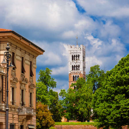 Arriving by train in Lucca. View of Lucca Cathedral medieval bell tower and ancient walls from city railways station Archivio Fotografico
