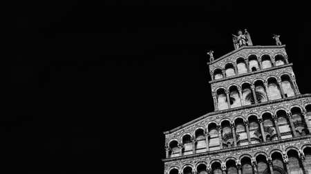 Romanesque architecture in Tuscany. St Micheal in Foro Church beautiful medieval facade in the city of Lucca, Tuscany, erected in the 13th century (Black and White with copy space)