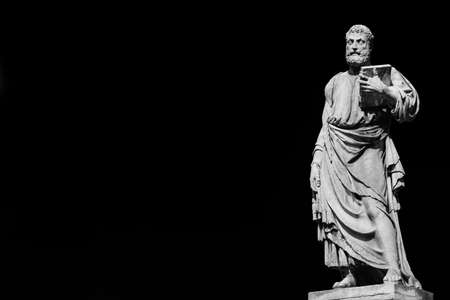 Saint Peter holding the key of heaven statue on Holy Angel Bridge in Rome, made in the 17th century by sculptor Lorenzetto (Black and White with copy space)