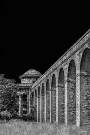 Ancient architecture in Tuscany. The stone temple-cistern of Lucca old aqueduct ruins built in neoclassical style in 1823 (Black and White with copy space above) Stock Photo