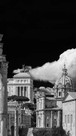 Ancient ruins, classical monuments and baroque church in the historic center of Rome (Black and White with copy space above)