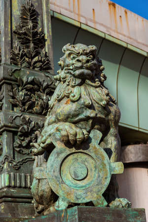 Lion bronze statue at the entrance of the old Nihonbashi Bridge in Tokyo