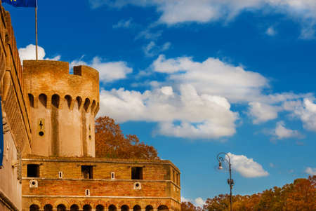 Autumn and foliage in Rome. Beautiful red and orange sycamore leaves outside Castel Sant'Angelo (Holy Angel Castle) walls Editorial