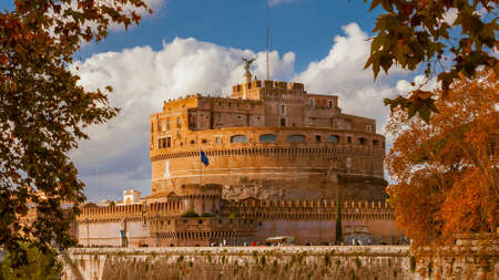 Autumn and foliage in Rome. The famous Castel Sant'Angelo (Holy Angel Castle) among sycamore orange leaves