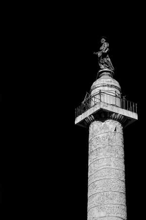 Ancient Trajan's Column in the historic center of Rome, built in 113 AD (Black and White with copy space)