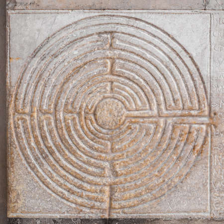 Mysterious ancient labyrinth relief at the entrance of Lucca Cathedral in Tuscany (12th century) Editorial