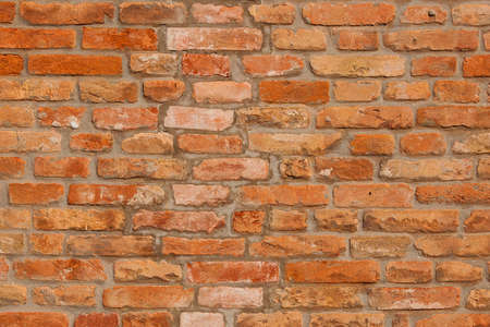 Orange and red brick wall as background Stock Photo