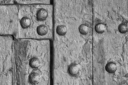 Old iron panel with bolts and rust as background