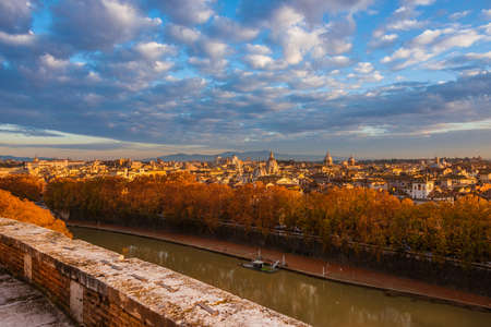 Autumn and foliage in Rome. Panoramic view of city historic center ancient skyline at sunset with beautiful autumnal leaves Stock Photo