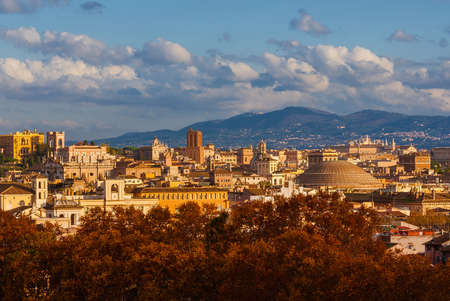 Autumn and foliage in Rome. The city historic center ancient skyline with the famous and iconic Pantheon dome rises above beautiful autumnal leaves Stock Photo