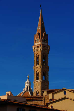 Medieval bell tower and St Mary of the Flower famous dome rise above Florence historic center roofs