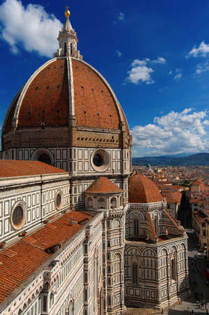 View of wonderful dome of Santa Maria del Fiore (St Mary of the Flower) in Florence with tourists at the top, built by italian architect Brunelleschi in the 15th century, a symbol of Renaissance in the world Stock Photo