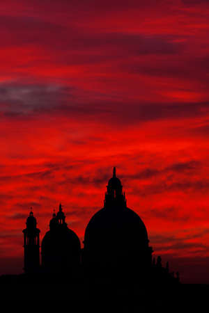 Mysterious red blood sky sunset over Venice Lagoon with Salute Basilica domes Stock Photo