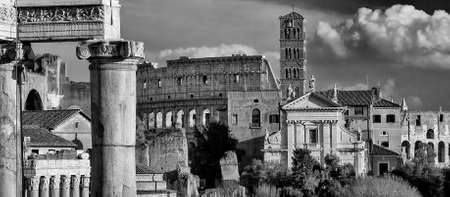 View of Roman Forum ancient ruins with Coliseum and baroque church (Black and White)
