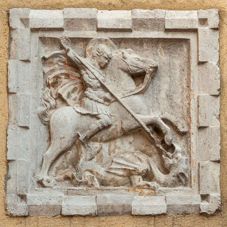 St George fights and kill the evil Dragon old relief on a Venice wall