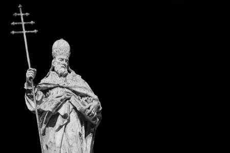 Pope Sylvester I statue with cross on black Standard-Bild