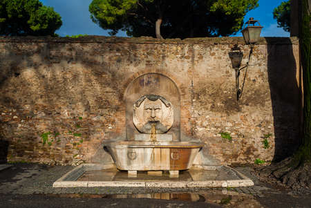 Fountain of the Mask of Saint Sabina, made in 1593 and now in Aventine Hill in Rome Stock Photo