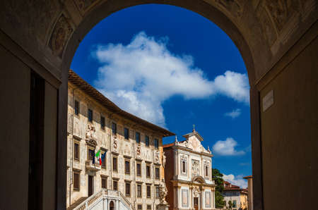 Knights' Square in Pisa, the 2nd most important place in the city and a jewel of the Italian Renaissance, seen through Arco dei Gualandi (Gualandi Gate) Stock Photo