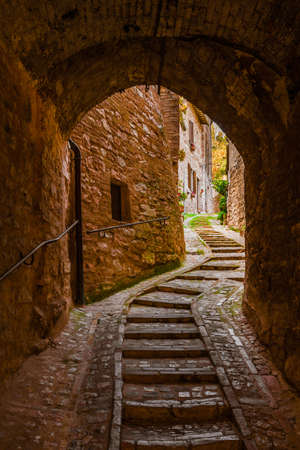 Characterictic lane with arch and staircase in Spello beautiful historic center