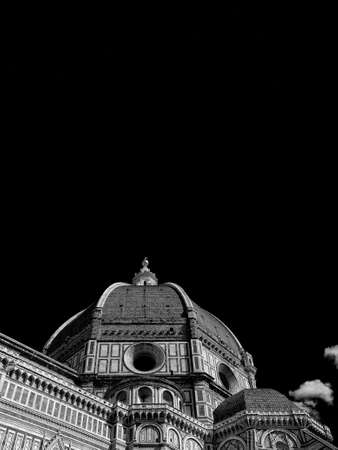 St Mary of the Flower iconic dome in Florence seen from below, built by italian architect Brunelleschi in the 15th century and symbol of Renaissance in the world (Black and White with copy space above)