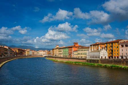 View of Pisa along River Arno with the characteristic gothic church of Santa Maria della Spina