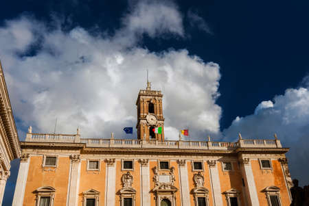 Rome City Hall with old clock tower among clouds at the top of Capitoline Hill in the center of Rome, designed by the famous renaissance artist Michelangelo in the 16th century Foto de archivo