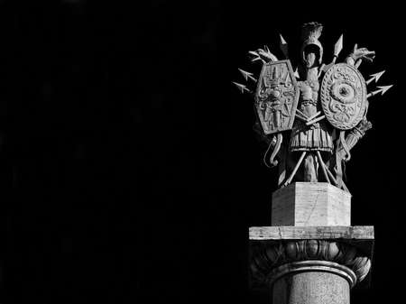Ancient roman weapons and armors from 19th century neoclassical monument in People's Square in Rome (Black and White with copy space)