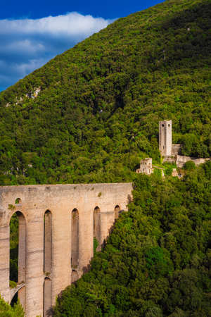 Ancient medieval Ponte delle Torri (Tower Bridge) ruins in Spoleto among woods