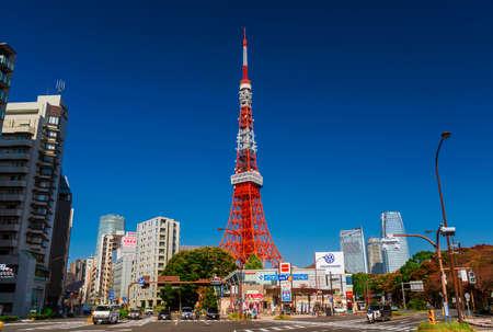 The iconic Tokyo Tower against blue sky seen from Shiba and Akenebashi areas