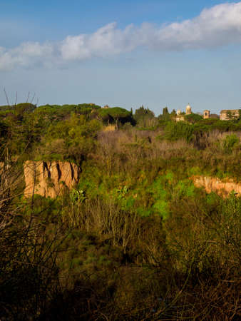 View of Tor Marancia urban park in Rome with the old Church of Saint Sebastian domes and belfry