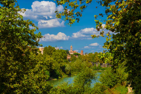 Nature in Rome. View of the city old historic center from River Tiber embankment full of trees