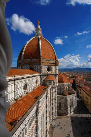 View of dome of Santa Maria del Fiore (St Mary of the Flower) in Florence with tourists at the top, built by italian architect Brunelleschi in the 15th century, a symbol of Renaissance in the world