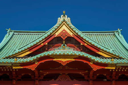 Kanda Shrine Main Hall Irimoya (hip-and-gable) roof with characteristic copper tiles built in the gongen-zukuri style, a beautiful sample of japanase traditional and religious architecture in Tokyo