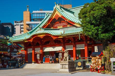 Spirituality in Tokyo. Japanese people praying at Kanda Shrine in Tokyo
