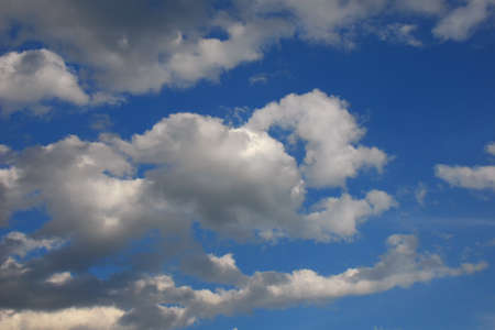 Heavenly blue sky with white clouds as background