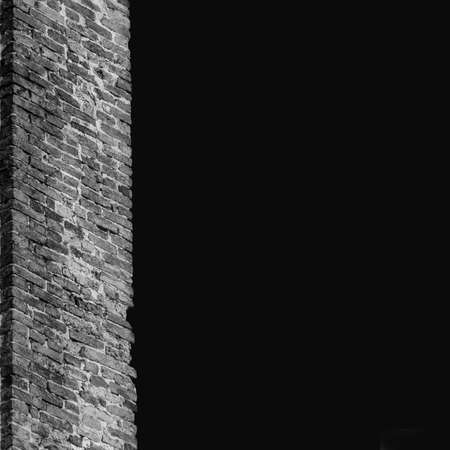Old brick wall as background (Black and White with copy space)
