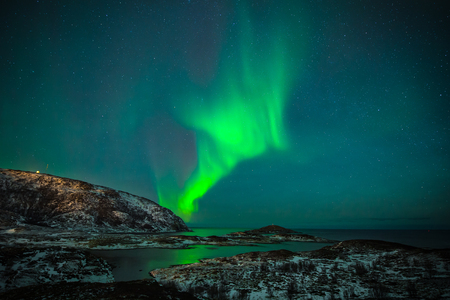 In Norway, the night sky becomes magical thanks to the northern lights, aurora borealis wonderful Stock Photo