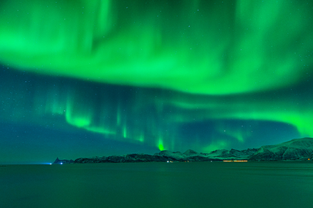The sky is close to explode like a magical night full of northern lights Stock Photo