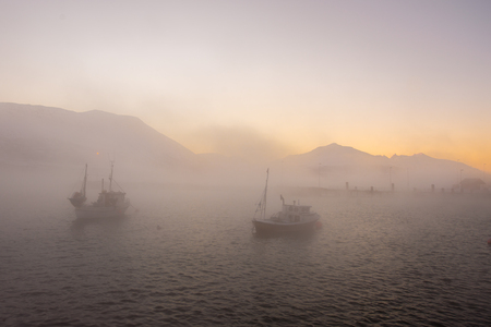 fishing boats in the icy fog of cold Norway