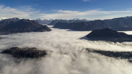 sea of fog above the lake of Lugano