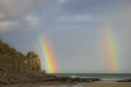 double rainbow on New Zealand beaches