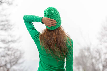 girl dressed in green with hat