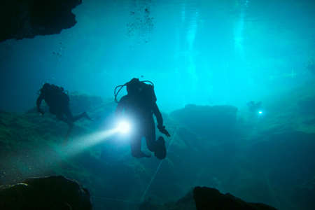 divers: Divers in cenote