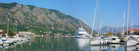 View on the port of Kotor with cruise ship and boats photo