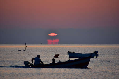 the firmament: Fisherman at sunset hour