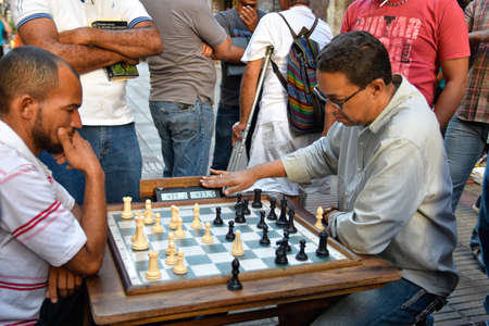 conde: Men playing chess in Conde Street. Santo Domingo, Dominican Republic. Editorial