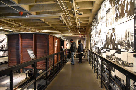 holocaust: Washington DC - December 19, 2015: Internal view of the Holocaust Memorial Museum. Real pictures of the deported Jews, Nazi propaganda, territory of conquest.