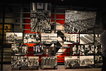 deported: Washington DC - December 19, 2015: Internal view of the Holocaust Memorial Museum. Real pictures of the deported Jews, Nazi propaganda, territory of conquest.