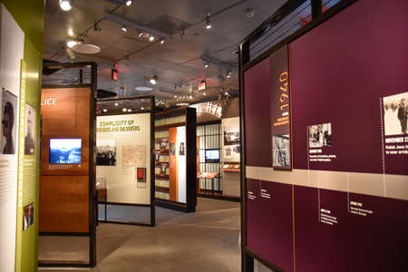 conquest: Washington DC, - December 19, 2015: Internal view of the Holocaust Memorial Museum. Real pictures of the deported Jews, Nazi propaganda, territory of conquest. Editorial
