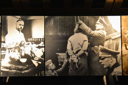 nazi: Washington DC - December 19, 2015: Internal view of the Holocaust Memorial Museum. Real pictures of the deported Jews, Nazi propaganda, territory of conquest.